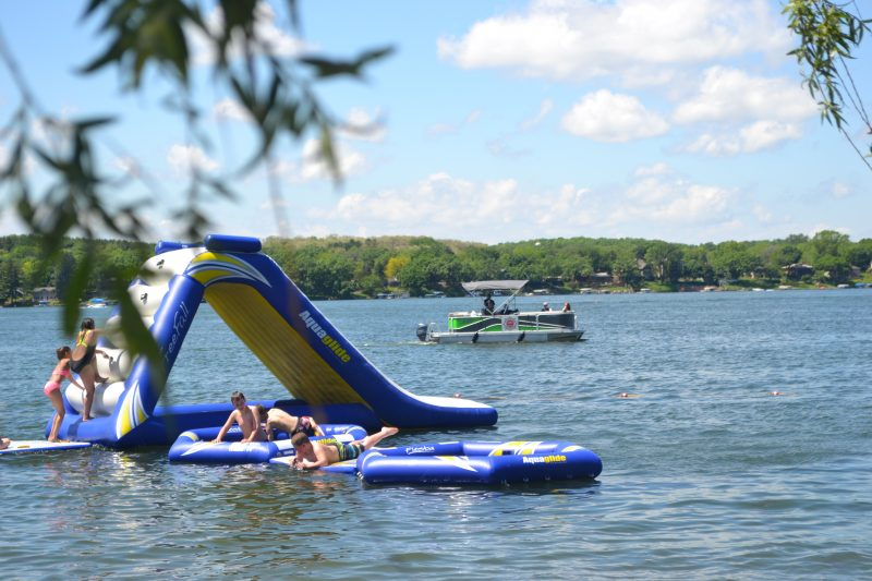 An image of kids using inflatables in the water.