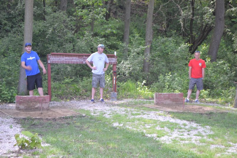An image of people playing with horseshoes.