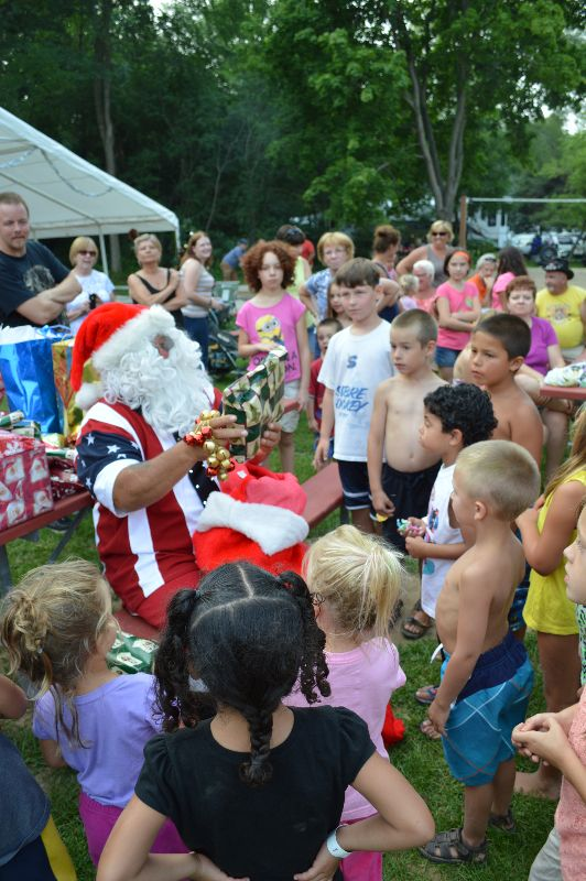 These are kids gathered around Santa Claus.
