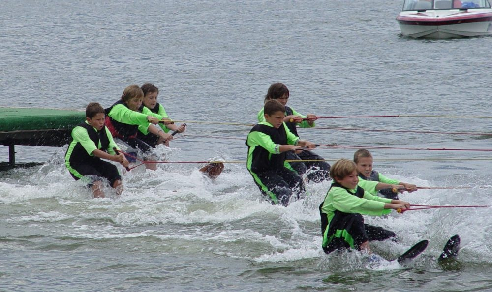 This is a team of boys water skiing.