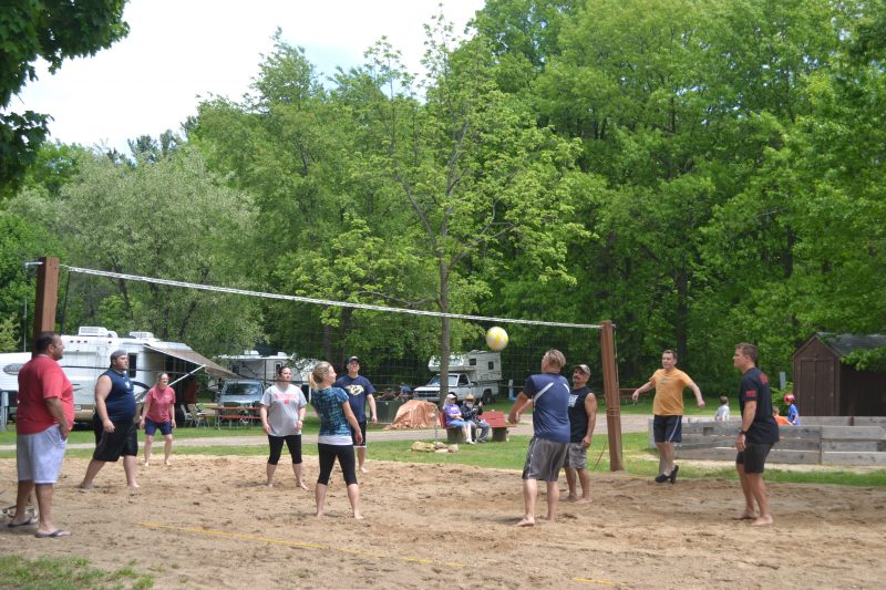 An image of people playing volleyball.