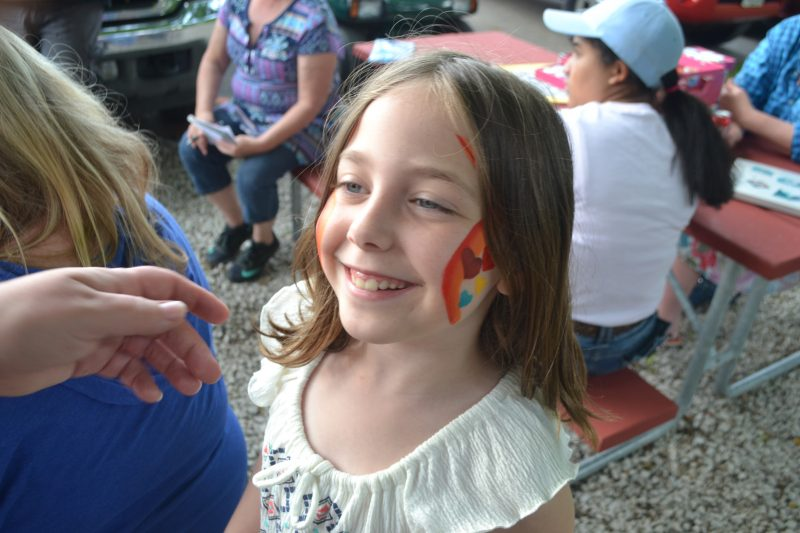 An image of a girl with face paint.